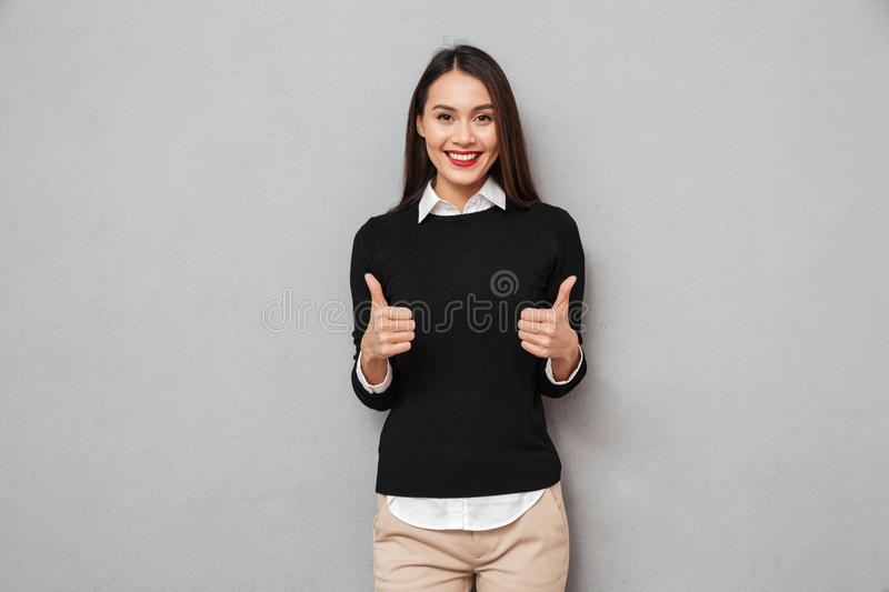 Happy asian business woman in business clothes showing thumbs up stock photos
