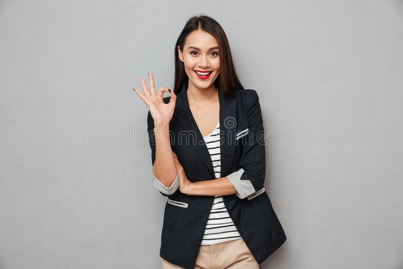 Happy asian business woman showing ok sign stock image