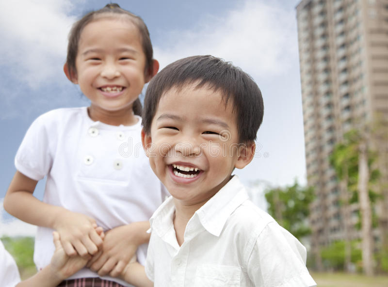 Happy asian children. Happy children in the city park royalty free stock photography