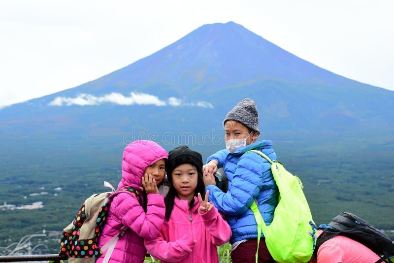 Happy Asian children at Kachi Kachi Ropeway. With Fujisan background,Japan royalty free stock image