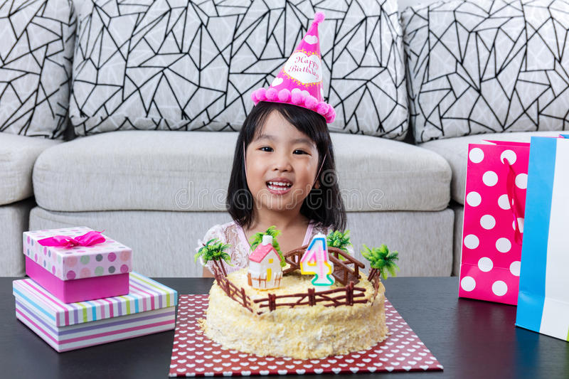 Happy Asian Chinese little girl with celebrating birthday. At home indoor stock photography