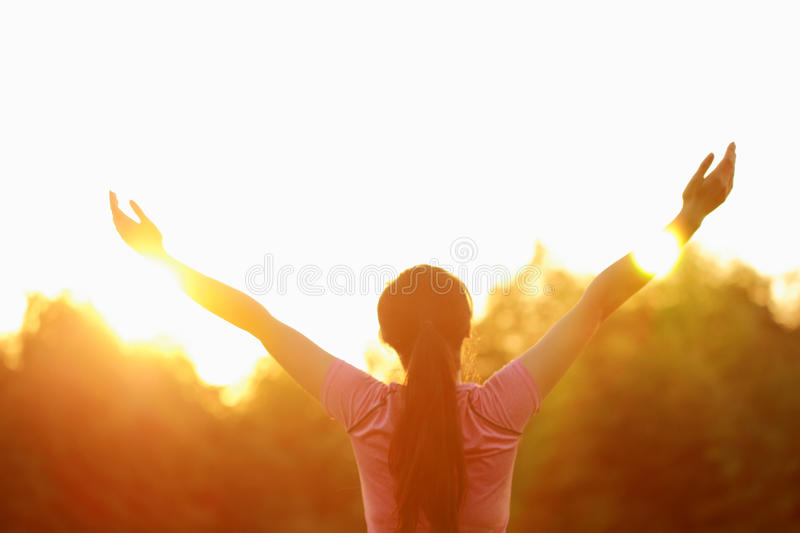 Happy Asian Chinese woman embrace nature and sun stock images