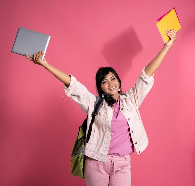 Happy asian college student raise her arm royalty free stock photography