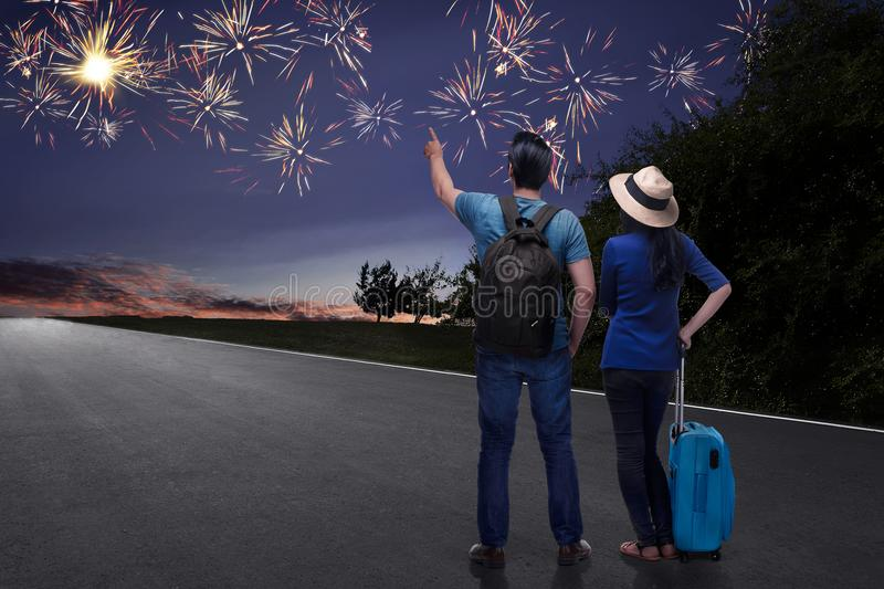 Happy asian couple tourist watching beautiful fireworks. At outdoor royalty free stock photos