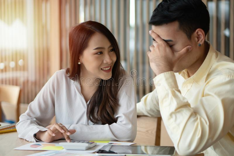 Happy Asian couples be smile after calculating income And expenses because it receives profits from investments. Concepts for inve. Stment planning and financial stock photography