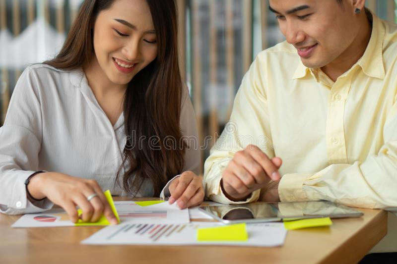 Happy Asian couples be smile after calculating income And expenses because it receives profits from investments. Concepts for stock photo