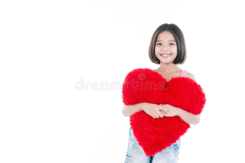 Happy Asian cute girl holding heart. Love concept photo with child girl in love holding red heart on white background. Love and valentines day asian girl royalty free stock images