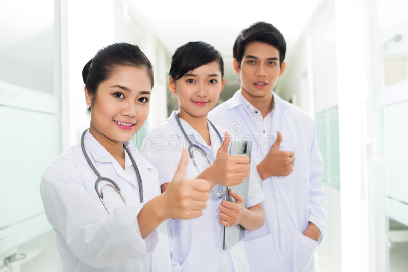 Download Happy Asian doctors stock image. Image of group, confidence - 28800475