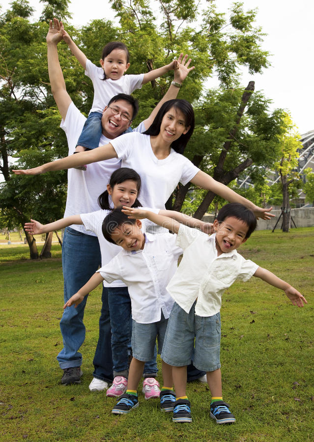 Happy asian family. In the park royalty free stock photos
