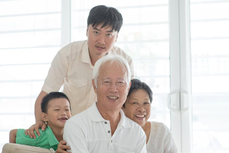 Portrait of Asian family at home royalty free stock image