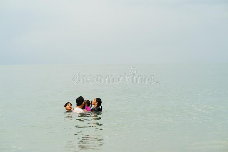 Happy Asian Family with Little Kid Having Fun at the Beach. Joyful Family. Travel and Vacation stock images