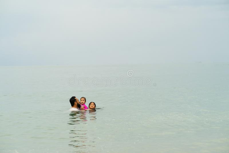 Happy Asian Family with Little Kid Having Fun at the Beach. Joyful Family. Travel and Vacation royalty free stock photos