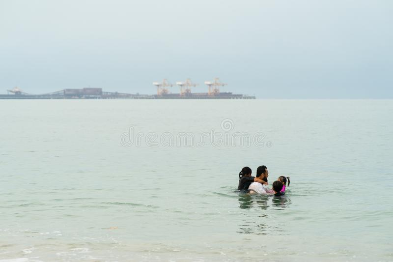 Happy Asian Family with Little Kid Having Fun at the Beach. Joyful Family. Travel and Vacation stock image