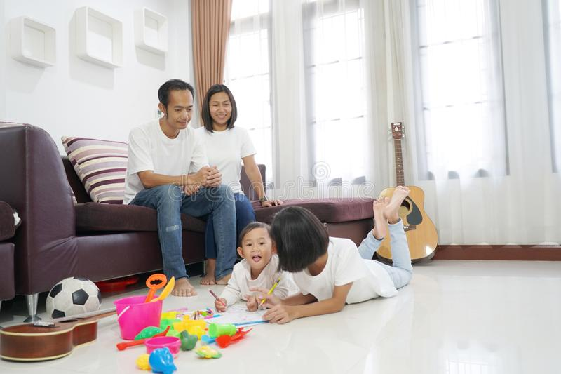 Happy asian family in living room at home stock photography