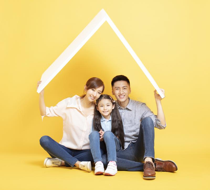 Asian family  in new house with roof concept royalty free stock images