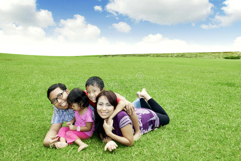 Happy Asian family outdoor stock images