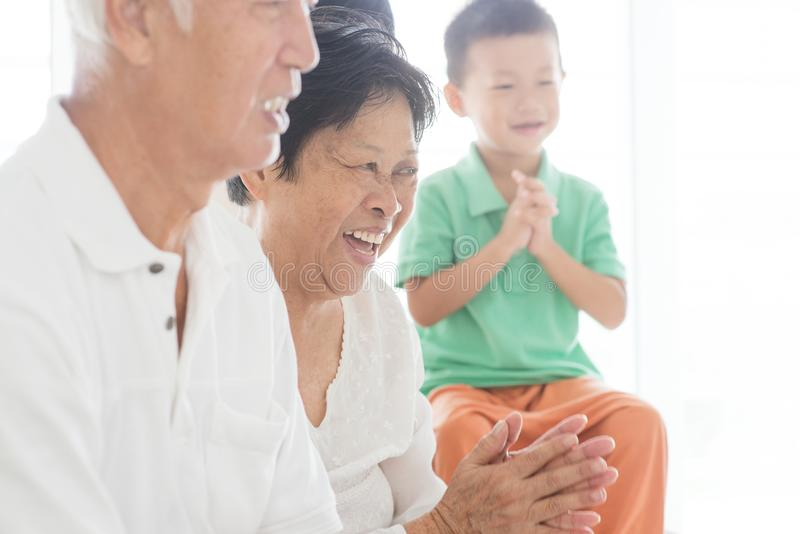 Happy Asian family clapping hands royalty free stock images