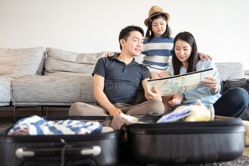 Happy asian family spending time together on sofa in living room. family and home concept. stock image