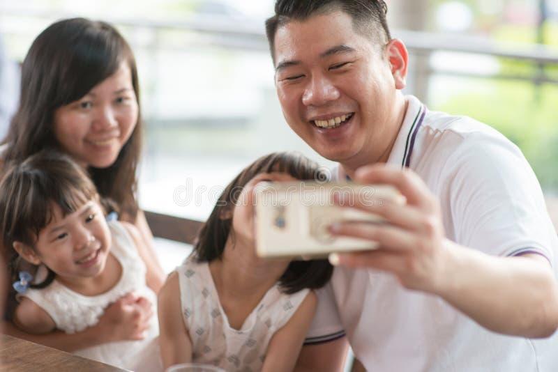 Family taking self photograph stock photo