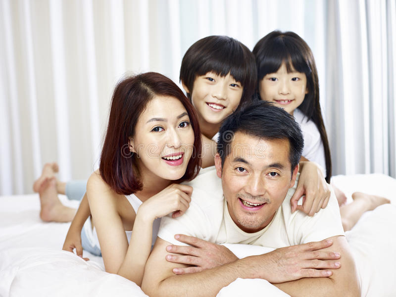 Portrait of asian family with two children royalty free stock photo
