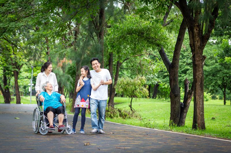 Happy asian family walking,care,talk,child girl or granddaughter and senior grandmother,father,mother having fun,laugh,smile, royalty free stock photos