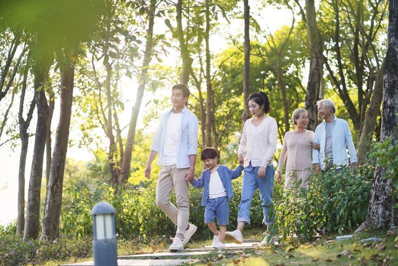 Happy asian family walking in park stock photos