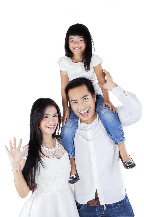 Happy Asian family on white background royalty free stock images