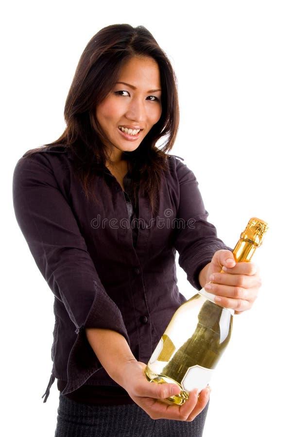 Happy asian female holding bottle stock image