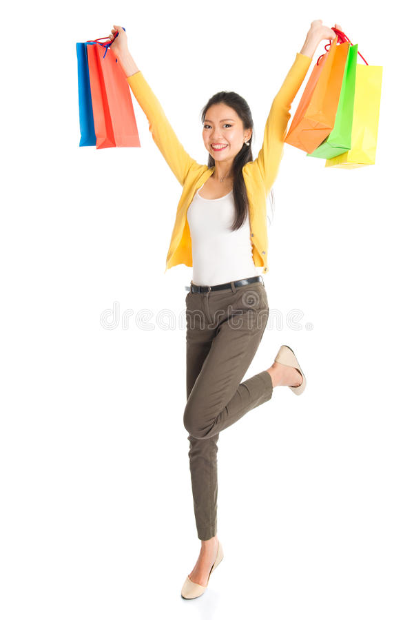 Happy Asian female with shopping bags royalty free stock photos