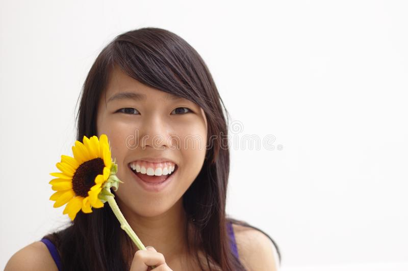 Happy asian flower teen girl stock images