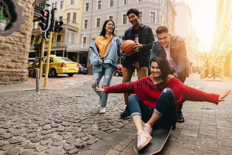 Happy asian friends enjoying in the city royalty free stock photos