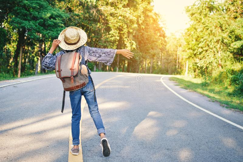 Happy Asian girl backpack in the road stock photography