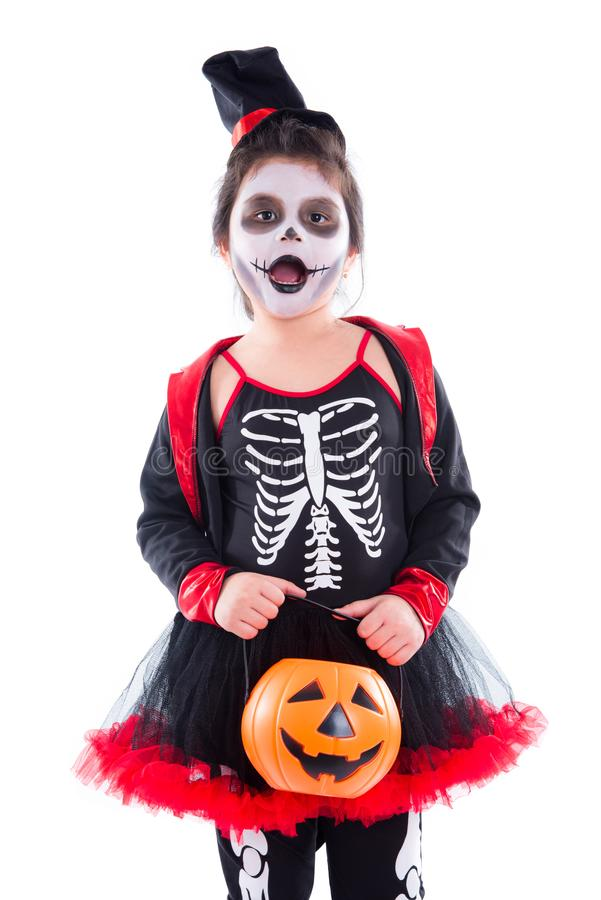 Happy girl in halloween skeleton costume over white. Happy asian girl in halloween skeleton costume isolated over white background royalty free stock images