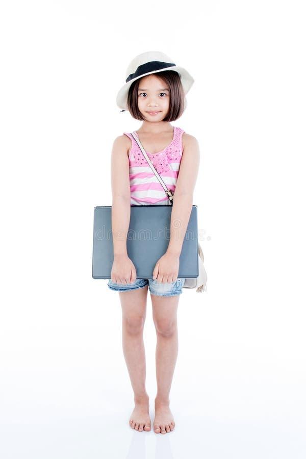 Happy asian girl holding laptop. On white background royalty free stock image