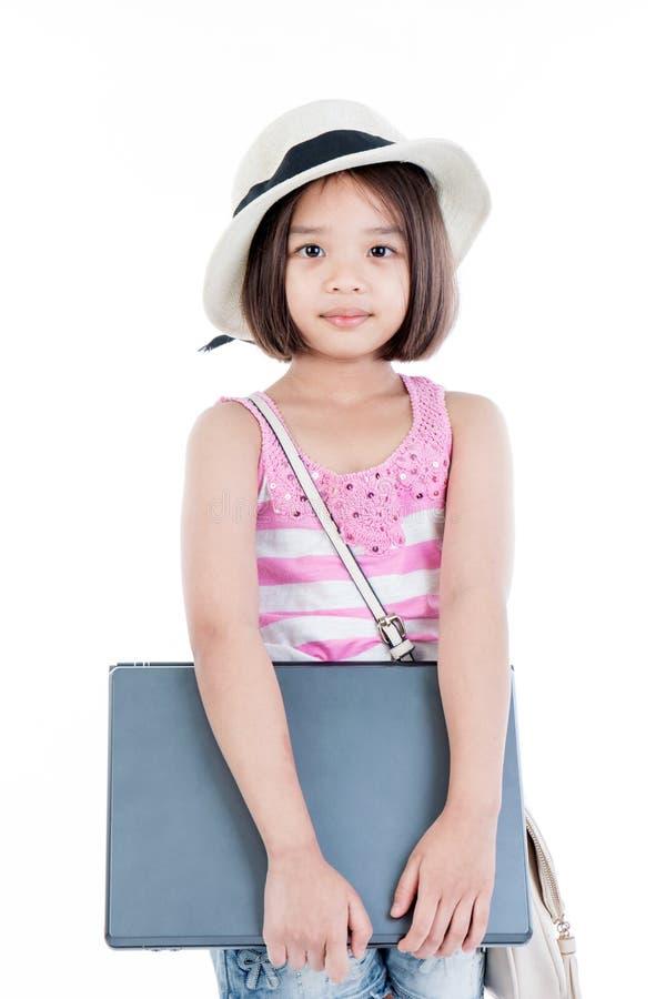 Happy asian girl holding laptop stock image