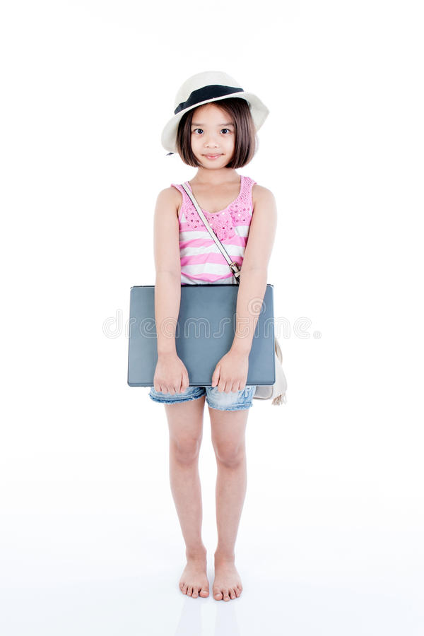 Happy asian girl holding laptop royalty free stock photos