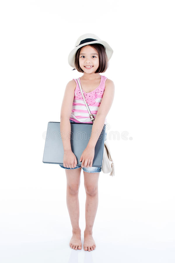 Happy asian girl holding laptop royalty free stock images