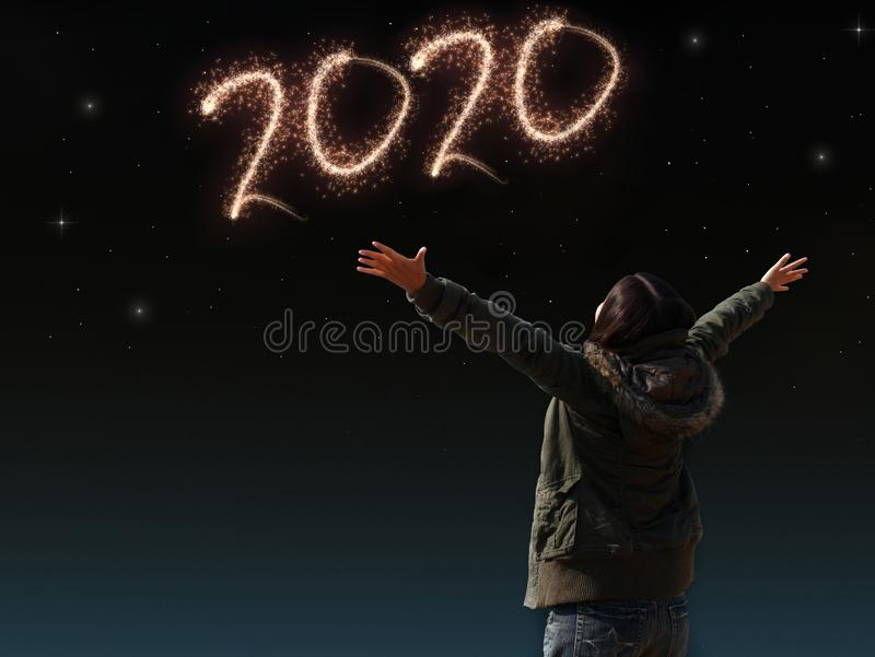 Happy Asian girl open arm with joyful on countdown night with firework light for 2020 year. image of happy new year celebration stock images