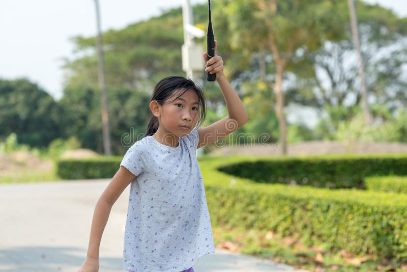 Asian girl playing badminton outdoor. stock images