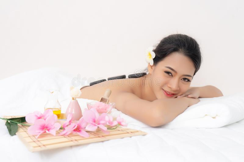 Happy Asian girl resting relaxing in spa resort looking at camera. stock photos