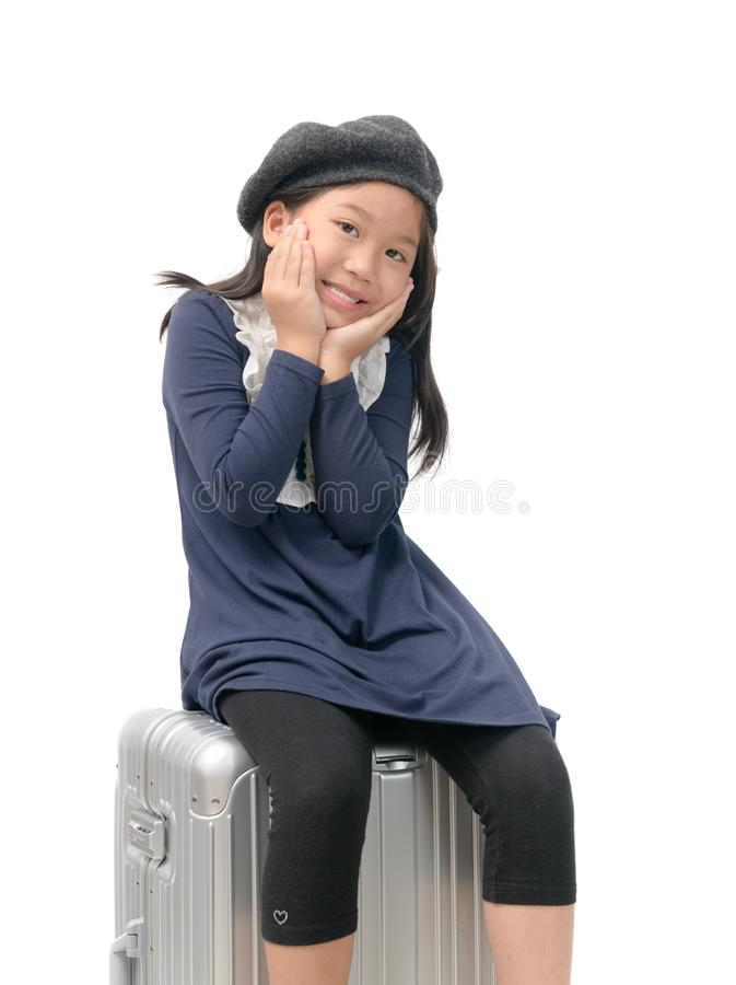 Happy asian girl sit on the baggage isolated royalty free stock images