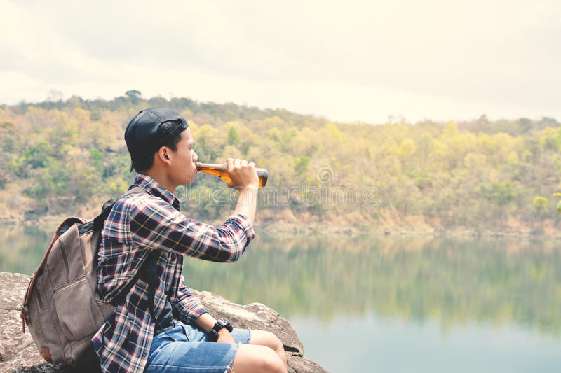 Happy Asian hipster man backpack. In nature background, Relax time on holiday concept travel , color of vintage tone and soft focus royalty free stock photos