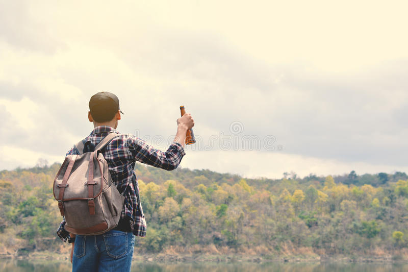 Happy Asian hipster man backpack. In nature background, Relax time on holiday concept travel , color of vintage tone and soft focus stock photos