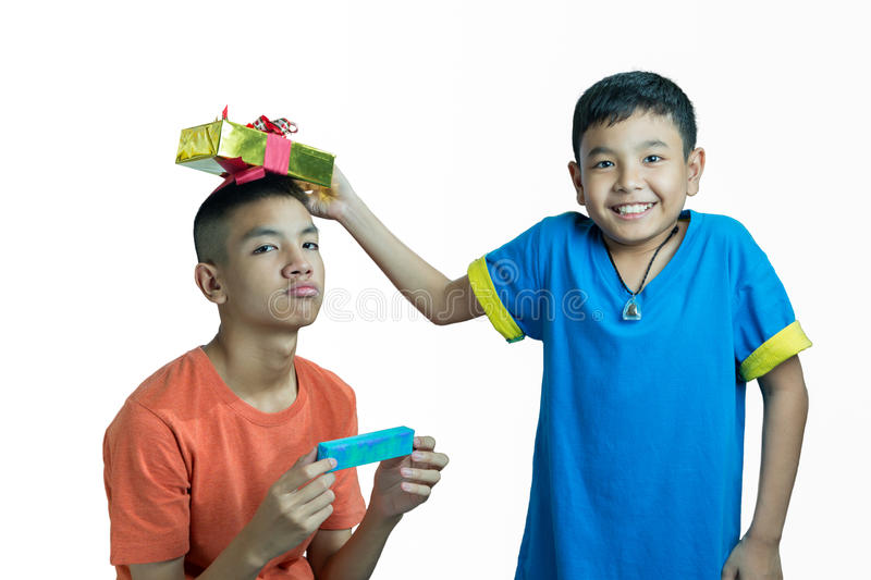 Happy Asian kid give present to his brother stock photos