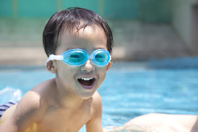 Happy asian kid in water. Happy asian kid in swimming pool royalty free stock images