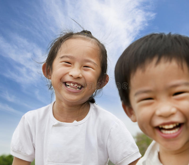 Happy asian kids. Happy asian boy and girl royalty free stock image