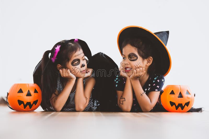 Happy asian little child girl having fun on Halloween celebration. Happy asian little child girl in costumes and makeup having fun on Halloween celebration royalty free stock photos
