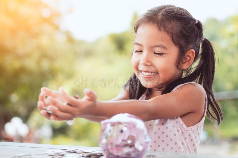Happy asian little child girl showing her money stock photos