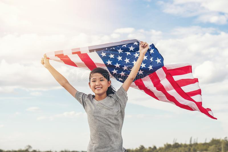 Happy asian little girl with American flag USA celebrate 4th of July stock images