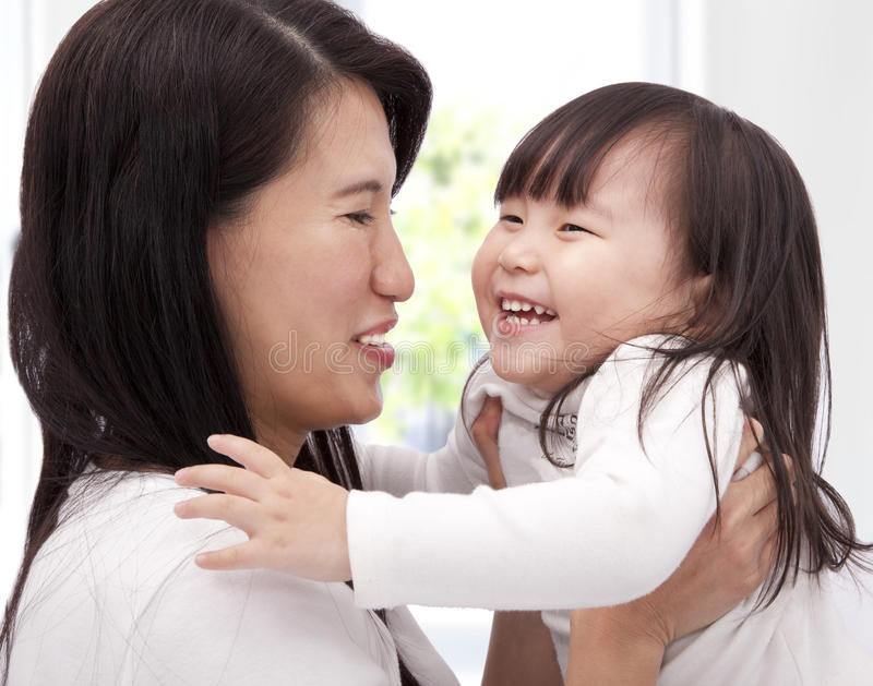 Happy asian little girl and her mother royalty free stock images